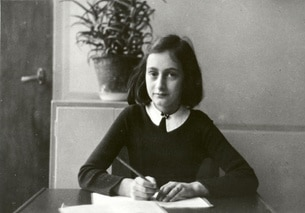 Anne Frank at her desk in Amsterdam
